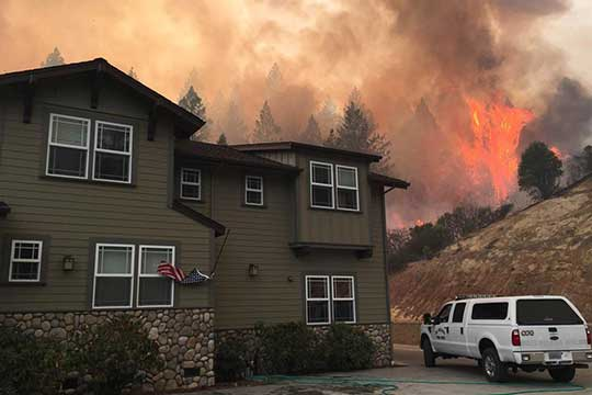 A house near the the area of an active wildfire